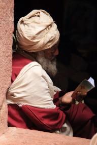 Reading prayer book, a Lalibela church