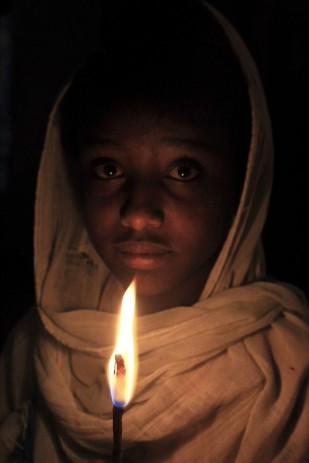 Young pilgrim at the Easter vigil, Lalibela
