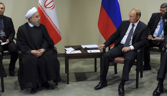 Russia's President Vladimir Putin (2nd R) meets with Iran's President Hassan Rouhani (2nd L) on the sidelines of the United Nations General Assembly in New York, September 28, 2015. REUTERS/Mikhail Klimentyev/RIA Novosti/Kremlin ATTENTION EDITORS - THIS IMAGE HAS BEEN SUPPLIED BY A THIRD PARTY. IT IS DISTRIBUTED, EXACTLY AS RECEIVED BY REUTERS, AS A SERVICE TO CLIENTS.   - RTX1SY30